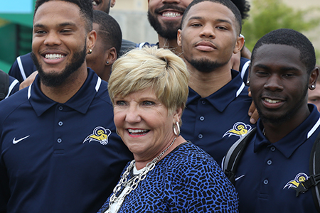 Mayor Price greets the Texas Wesleyan basketball team at the Rosedale Renaissance Dedication Ceremony October 2015.