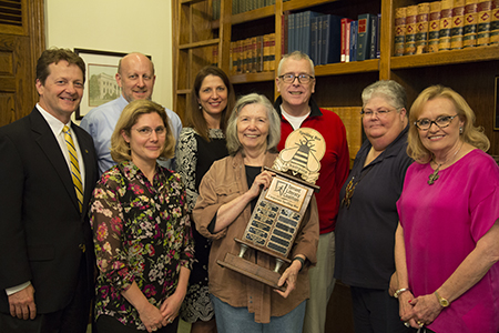 Representatives from the Tarrant Literacy Coalition, Kathryn B. Thompson, executive director, and Jane Nober, chairman of the board, were on campus May 13 to present the Corporate Spelling Bee traveling trophy to the Wesleyan Crushers.