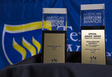"The Fort Worth chapter of the American Advertising Federation awarded Texas Wesleyan University with two gold awards and one silver award for its ""Smaller. Smarter."" campaign at the 2015 Addy Awards last Friday."